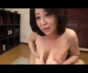 Japanese mature gives a great titfuck - 9 min