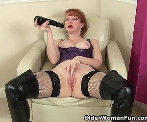 British milf Red fucks a big black dildo