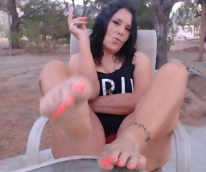 MATURE MOM smokes with pussy & foot play at dawn outside